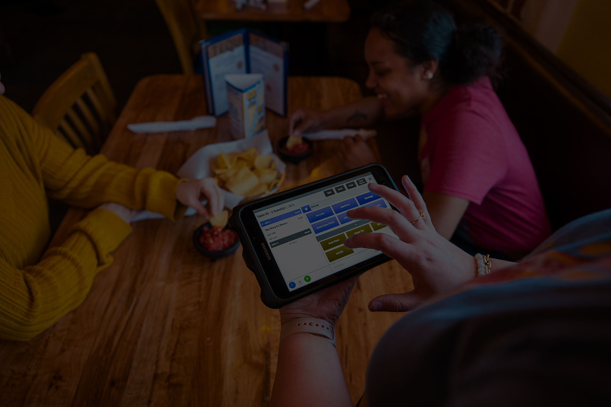 server using a mobile device for ordering from guests